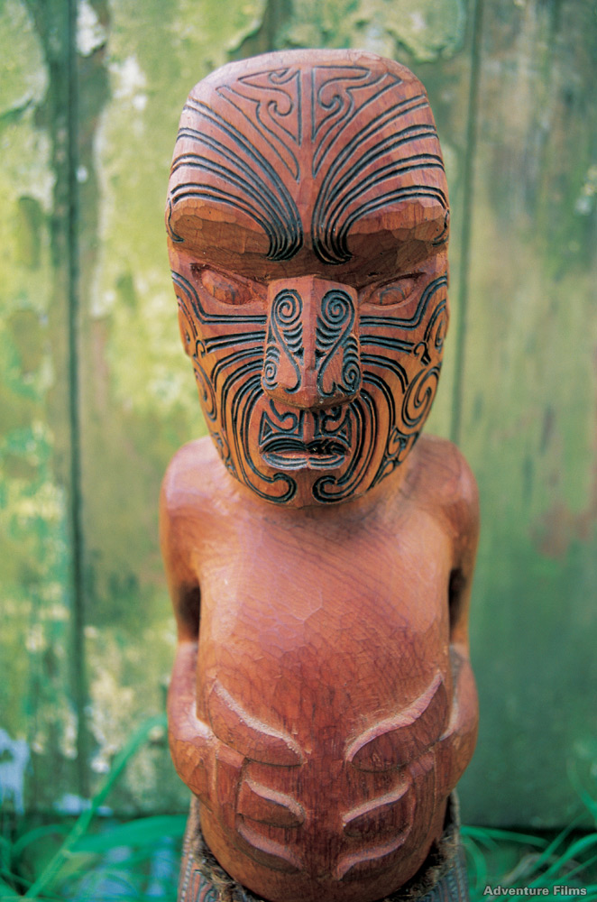 Carved figure with Moko | Photo Credit: Tourism New Zealand