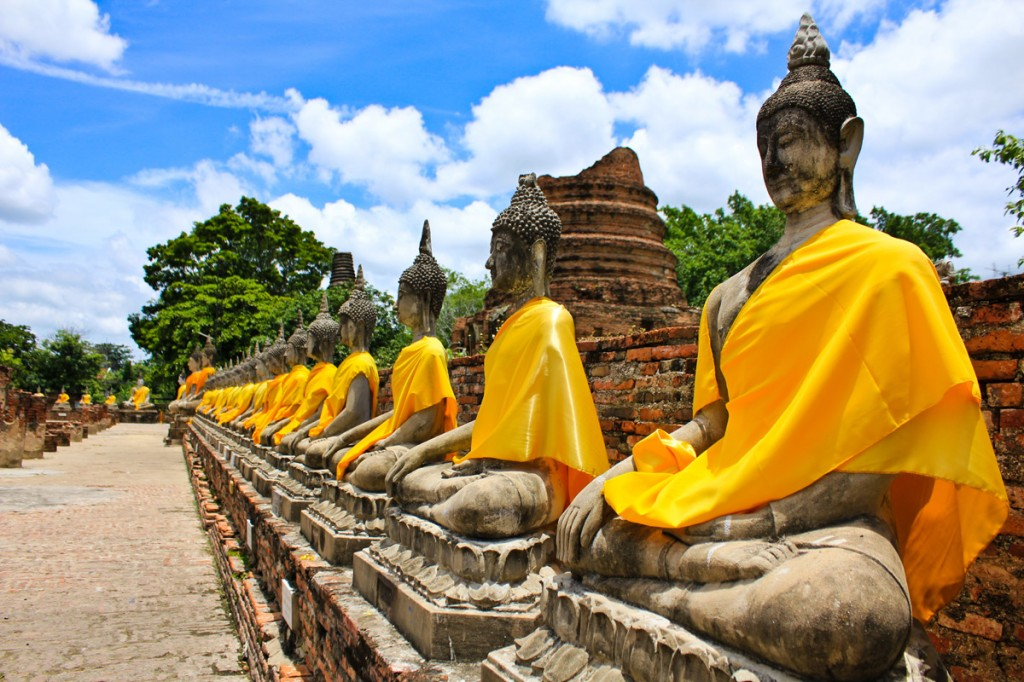 Buddha statues at the temple of Wat Yai Chai Mongkol in Ayutthaya near Bangkok, Thailand | Photo Credit: Shutterstock