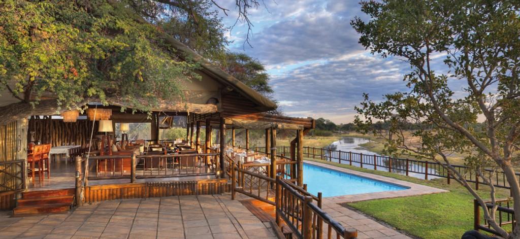 Savute Elephant Camp Lounge, Bar and Swimming Pool overlooking the Savute channel | Photo Credit: Savute Elephant Camp